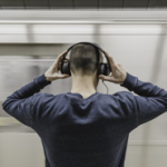 Man Listening to Music on Tube