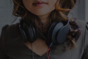 Girl with headphones around neck