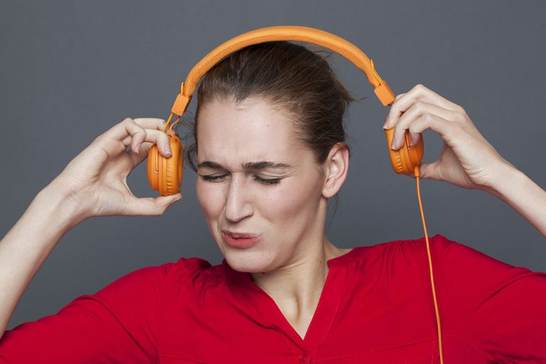 Girl wearing really loud headphones