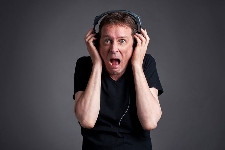 Man listening to very loud music